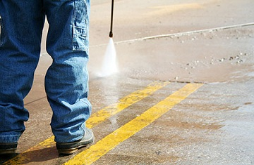 Parking lot power washing from Grease Masters